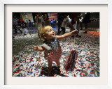 Eleven-Month-Old Adrianna Wagner Braces for More Confetti as She and Other Children Play Framed Photographic Print