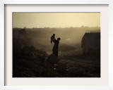 Displaced Man Holds His Baby Next to His Tent in Jalozai Refugee Camp Near Peshawar, Pakistan Framed Photographic Print