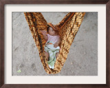 Four-Month-Old Rianto Sleeps in a Batik Cloth Swing, at a Refugee Camp in Lamreh, Indonesia Framed Photographic Print
