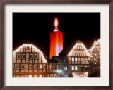 A Huge Christmas Candle Appears Above the Roofs in the Old City of Schlitz, Germany Framed Photographic Print by Heribert Proepper