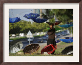 Pakistani Road Side Vendor Standing Next to His Display of Umbrellas for Sale Framed Photographic Print