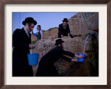 Ultra-Orthodox Jewish Men Stand Next to a Well as They Fill Canisters with Water in Jerusalem Framed Photographic Print