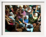 Abandoned Elderly Women Raise Hands During a Prayer Meeting Framed Photographic Print by M. Lakshman