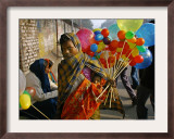 A Woman Sells Balloons During a Religious Procession Framed Photographic Print