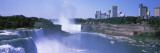 Waterfall With City Skyline in The Background, Niagara Falls, Ontario, Canada Wall Decal by  Panoramic Images