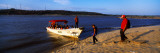 Tourists With a Boat at The Riverside, Orinoco, Ciudad Bolivar, Bolivar State, Venezuela Wall Decal by  Panoramic Images