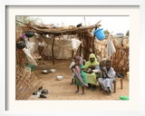 A Sudanese Family is Seen Inside Their Thatched Hut During the Visit of Unicef Goodwill Ambassador Framed Photographic Print