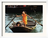 Sisters Who Live with Their Family on Halong Bay, Vietnam, Row Their Boat out to Greet Tourists Framed Photographic Print