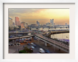A Traffic Jam at Sunset on One of Cairo's Bridges Spanning the Nile River, Egypt, May 20, 2001 Framed Photographic Print by Enric Marti