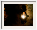 A Palestinian Boy Holds a Sparkler after Breaking the Fast on the First Day of Ramadan in Gaza City Framed Photographic Print