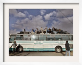 Palestinians Sit on Top of a Bus Framed Photographic Print