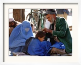 A Mother Watches as Her Child Gets a Haircut in the Center of Kabul, Afghanistan on Oct. 9, 2003. Framed Photographic Print