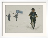 A Young Afghan Boy Rides His Bicycle on a Snow Covered Street Framed Photographic Print