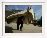 An Iraqi Man Trudges Under the Weight of a Couch He Looted from a Gated Elite Housing Compound Framed Photographic Print