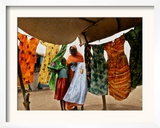 A Sudanese Woman Buys a Dress for Her Daughter at the Zamzam Refugee Camp Framed Photographic Print