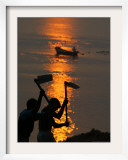 Indian Laborers Work on the Banks of the River Ganges at Sunset Framed Photographic Print