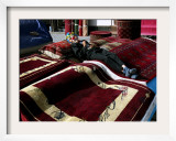 A Masked Boy Rests at a Carpet Shop in Kabul, Afghanistan, Friday, September 22, 2006 Framed Photographic Print by Rodrigo Abd