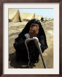 A Woman Washes Her Face with Water from a Tap at a Camp for Displaced Iraqis Framed Photographic Print