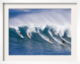 Surfers Ride a Wave at Waimea Beach on the North Shore of Oahu, Hawaii Framed Photographic Print