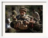 An Elderly Pakistani Earthquake Survivor Rushes Towards a Helicopter Carrying a Child in His Arms Framed Photographic Print