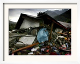 A Pakistani Earthquake Survivor Takes Shelter from the Rain Framed Photographic Print