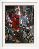 Indian Trishaw Driver Takes a Statue of Santa Claus to a Shop for Christmas Decoration in Agartala Framed Photographic Print