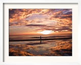 A Young Boy Takes an Early Morning Jog as the Sun Rises Along China Beach Framed Photographic Print