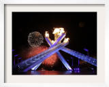 Fireworks Explode Behind the Olympic Flame at Opening Ceremony of Vancouver 2010 Winter Games Framed Photographic Print