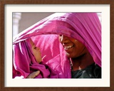 A Woman Shields Her Child from the Sun Using Her Scarf Framed Photographic Print