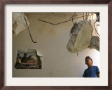 A Palestinian Boy Looks Inside the Damaged House of Militants Moatasm Sharaidi and Elias Ashkar Framed Photographic Print