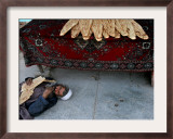 A Beggar Sleeps Next to a Bakery in Kabul, Afghanistan, Wednesday, June 7, 2006 Framed Photographic Print by Rodrigo Abd