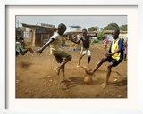 Young Children Play Soccer on a Dirt Pitch by the Side of Railway Tracks Framed Photographic Print