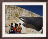 A Group of Children Fly Plastic Bags, Known as Papalotes Framed Photographic Print by Javier Galeano