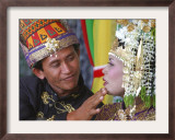 An Acehnese Bridegroom Cleans Face of His Bride During a Mass Wedding for Tsunami Victims Framed Photographic Print
