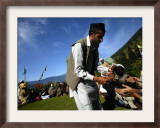 A Devotee Distributes Holy Charms to Fellow Devotees at a Forest Shrine of Miyan Peer Framed Photographic Print