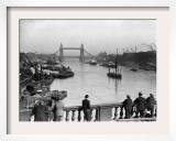 Pedestrians on London Bridge Watch Boats and Barges Being Unloaded Framed Photographic Print