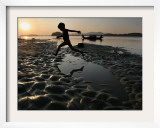 A Boy Plays on the Banks of the River Brahmaputra in Gauhati, India, Friday, October 27, 2006 Framed Photographic Print by Anupam Nath
