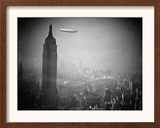 The Zeppelin Hindenburg Floats Past the Empire State Building Framed Photographic Print