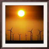 A Group of Wind Turbines are Silhouetted by the Setting Sun Framed Photographic Print by Charlie Riedel