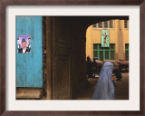 An Afghan Woman Wearing Burqa Walks Under a Bridge with Posters of Afghan President Hamid Karzai Framed Photographic Print