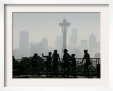 Members of the Cascade Bike Club Pause and Take in a Foggy View of the Space Needle Framed Photographic Print by Ted S. Warren