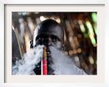 A Sudanese Man with Traditional Scars on His Face Relax with a Waterpipe Framed Photographic Print