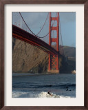 Surfer Rides a Wave Near the Golden Gate Bridge in San Francisco Framed Photographic Print