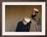 Afghan Refugee Teacher Adjusts the Turban for His Student Framed Photographic Print