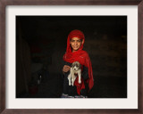 Girl Holds a Puppy as the Sun Sets over Kabul's Impoverished Teppe Maranjan Neighborhood Framed Photographic Print