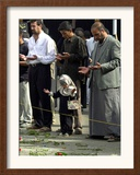 Iraqis, Inluding a Little Girl, Pause to Pray Framed Photographic Print