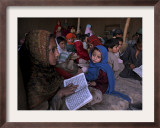 Afghan Refugee Children Holding Copies of the Quran, Repeat after their Teacher Framed Photographic Print