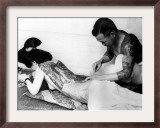 An Unidentified Japanese Tattoo Artist Works on a Woman's Backside Framed Photographic Print