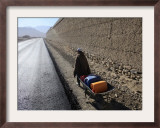 Child Uses a Wheel Barrow to Carry Jugs of Water, Logar Province, Afghanistan Framed Photographic Print