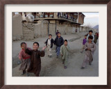 Children Play with a Soccer Ball Framed Photographic Print